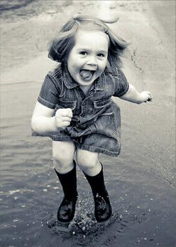 Happy Little Girl Jumping in Puddles Funny Birthday Card for